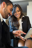 Business couple with tablet Stock Photos