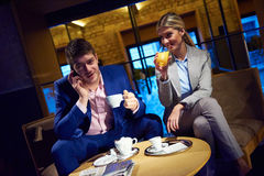 Business couple take drink after work Royalty Free Stock Images