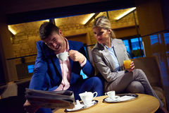 Business couple take drink after work Royalty Free Stock Photography