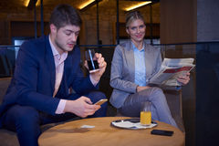 Business couple take drink after work Stock Images