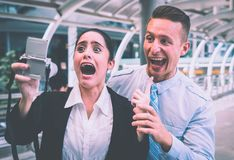 Business couple taking funny crazy selfie with camera stock photo