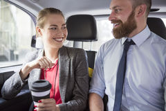 Business couple in taxi Royalty Free Stock Photos