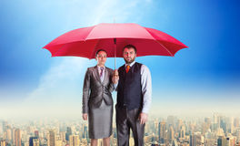 Business couple under umbrella Stock Photography