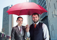 Business couple under umbrella Royalty Free Stock Image