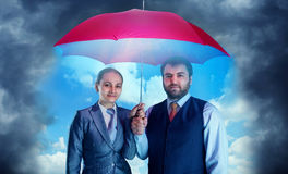 Business couple under umbrella Royalty Free Stock Photography