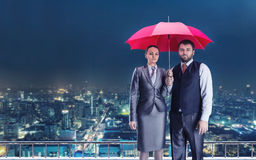 Business couple under umbrella Royalty Free Stock Photo