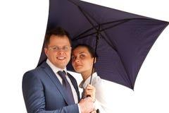 Business couple under an umbrella Stock Photo