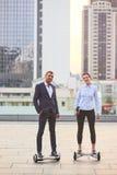 Business couple on urban background. Stock Photos