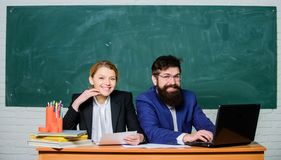 Business couple use laptop and documents. paper work. office life. teacher and student on exam. back to school. Non stock photos