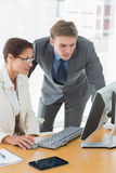 Business couple using computer at office desk Royalty Free Stock Photography