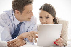 Business couple using digital tablet in hotel Royalty Free Stock Image