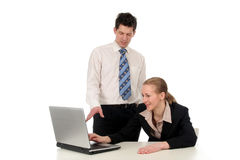 Business couple using laptop Royalty Free Stock Image