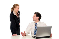 Business couple using laptop Stock Photography
