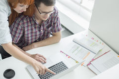 Business couple using laptop in creative office Royalty Free Stock Photos