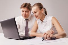 Business couple using laptop Stock Photos