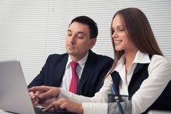 Business couple using laptop Stock Photo