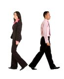 Business couple walking away Royalty Free Stock Images