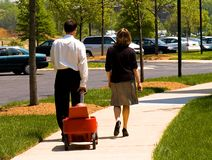 Business couple walking baby Royalty Free Stock Image