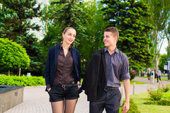 Business couple. Walking down the street and talking outdoors Royalty Free Stock Photos