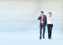 Business Couple Walking Together Stock Photos