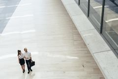 Business couple walking together royalty free stock images