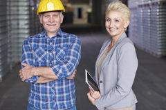 Business couple in warehouse Stock Photography