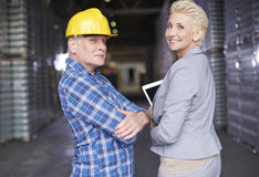 Business couple in warehouse Royalty Free Stock Photography