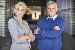 Business couple in warehouse Royalty Free Stock Image