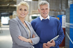 Business couple in warehouse Stock Photo