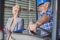 Business couple in warehouse Stock Image