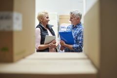Business couple in warehouse Royalty Free Stock Photos