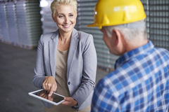 Business couple in warehouse Royalty Free Stock Photo
