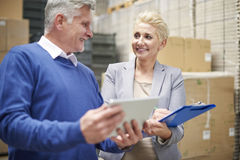 Business couple in warehouse Stock Photos
