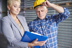 Business couple in warehouse Stock Images