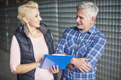 Business couple in warehouse Royalty Free Stock Images