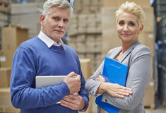 Business couple in warehouse. You really can trust us Stock Photo