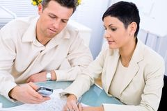 Business couple working. At office Royalty Free Stock Photos
