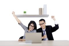 Business couple celebrating their success Royalty Free Stock Photo