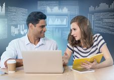 Business couple working on laptop with screen text interface Stock Images