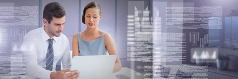 Business couple working on laptop with screen text interface. Digital composite of Business couple working on laptop with screen text interface Stock Photo