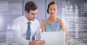 Business couple working on laptop with screen text interface. Digital composite of Business couple working on laptop with screen text interface Stock Image