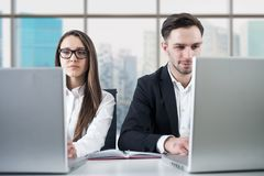 Business couple working in office Stock Photos