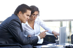 Business couple working outdoors Royalty Free Stock Photography