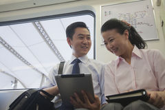 Business couple working in the subway Stock Photos