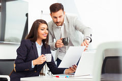 Business couple working together on project at modern office Stock Photos