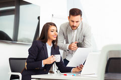 Business couple working together on project at modern office Stock Image