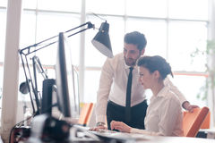 Business couple working together on project Royalty Free Stock Photos