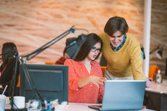 Business couple working together on project at modern startup office Stock Photos