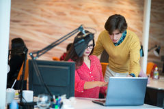 Business couple working together on project at modern startup office Royalty Free Stock Image