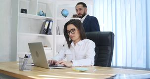 Business couple working together on project at modern startup office stock video footage